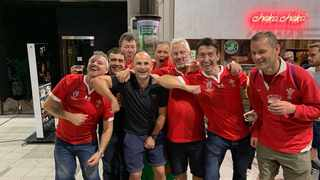 South African referee Jaco Peyper (black shirt) could be seeing red again from World Rugby after a photograph has emerged showing him with Welsh fans appearing to be mocking French lock Sebastien Vahaamahina. Photo: Twitter