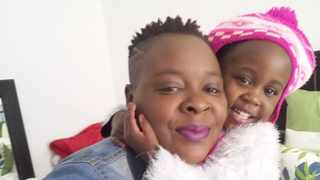Chiedza Sjambok cuddles her one-year-old daughter Britney Ruguwa, who died in April after she was hit by a car at the Busy Bears créche in Johannesburg. Photo: Supplied.