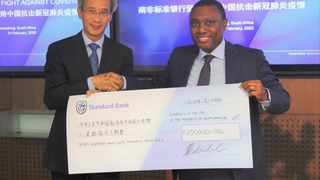 Chinese ambassador to South Africa Lin Songtian receives a cheque of R750,000 from Standard Bank Group CEO Sim Tshabalala. The restriction of movements to and from China in the wake of the outbreak of COVID-19, caused by the coronavirus, has negatively impacted Zimbabwe's tourism industry and small to medium enterprises, local media reported on Tuesday.  PHOTO: Embassy of China