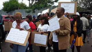Members of the #IamSelina'sVoice campaign protest outside the Bafokeng Magistrate's Court in Tlhabane near Rustenburg, during the court appearance of a man accused of beating her to death. Photo: Molaole Montsho/ANA