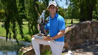 Victor Lange holding his IGT Challenge Tour event number 11 trophy on January 5. Lange has no symptoms and is expected to make a full recovery Photo: CJ du Plooy