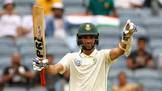 South African batsman Keshav Maharaj celebrates his half-century during the third day of the 2nd Test Match between India and South Africa at MCA Stadium in Pune on Saturday. Photo: ANI Photo