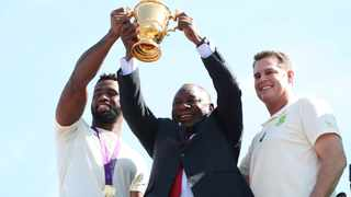 South Africa president Cyril Ramaphosa with head coach Rassie Erasmus and Siya Kolisi lift the Rugby World Cup trophy. Photo: REUTERS