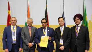 22072018 (Durban) The BRICS Business Council leaders from L-R Sergey Katyrin (Russia), Paulo Cesar de Silva eSouza (Brazil), Dr Iqbal Survé (South Africa), Xu Lirong (China) and Onkar Kanwar (India) signing the annual report after its adoption in Durban on Monday. Picture: Motshwari Mofokeng/ African News Agency/ANA