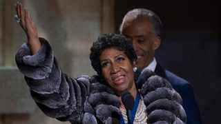 Aretha Franklin speaks to the crowd in front of Reverend Al Sharpton during the BET Honors 2014 at Warner Theatre in Washington February 8, 2014. REUTERS/Jose Luis Magana (UNITED STATES - Tags: ENTERTAINMENT)