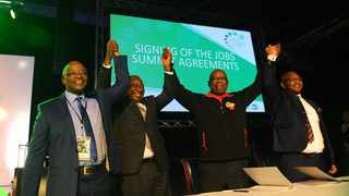 Business leader Sipho Pityana, left, President Cyril Ramaphosa, second left, Bheki Ntshalintshali, second right, and Thulani Tshefutha, right, at the signing of the continuance job summit agreement at Gallagher Convention Centre in Midrand in 2018. Ramaphosa has commended social partners for the progress in implementing the commitments made at the Presidential Jobs Summit in October 2018. Picture: Bhekikhaya Mabaso African News Agency (ANA)
