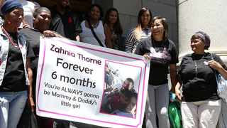 Murdered 6-month-old Zahnia Woodward's mother Cindy Woodward poses with friends and family outside the Cape High Court after the judgement where Christopher September and Larry Johnson was found guilty of murdering Zahnia. Picture: Brendan Magaar/African News Agency (ANA)