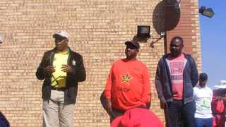 Survivor of an alleged racial road rage attack, Lawrence Nelumoni (first from right wearing a black jean) listens to Nkangala regional chairman of the African National Congress (ANC) Speedy Mashilo (first from left) while addressing a crowd of ANC members before they marched to the Middelburg Magistrate's Court against racism late last month. FILE PHOTO: ANA  Picture: Balise Mabona