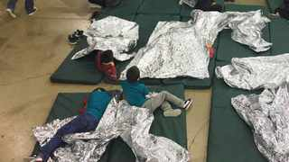 People who were taken into custody related to cases of illegal entry into the United States rest in one of the cages at a facility in McAllen, Texas. File picture: US Customs and Border Protection's Rio Grande Valley Sector via AP