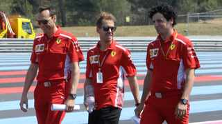 Sebastian Vettel, centre, walks the Paul Ricard circuit with two of his crew ahead of the Franch Grand Prix, a Thursday ritual which is much more important this time as Vettel has never raced there before. Picture: Claude Paris / AP