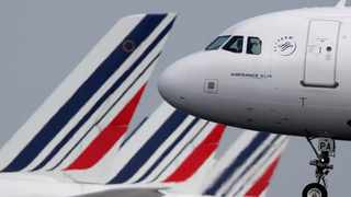 FILE PHOTO: An Air France Airbus A320 airplane lands at the Charles-de-Gaulle airport in Roissy.