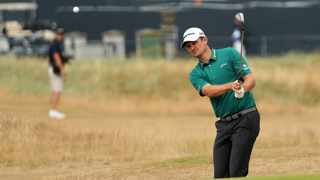 Justin Rose of England chips on to the 16th green at Carnoustie on Saturday. Photo: Peter Morrison/AP