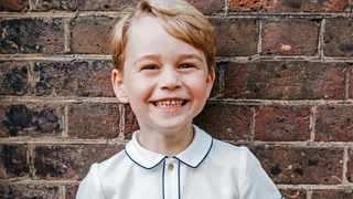 Britain's Prince George poses for a photograph to mark his 5th birthday on Sunday 22nd July, in the garden at Clarence House in central London