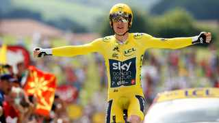 Britain's Geraint Thomas, wearing the overall leader's yellow jersey reacts as he crosses the finish line during the twentieth stage of the Tour de France. Photo: Christophe Ena/AP Photo