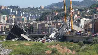 Rescuers work at the site of the collapsed bridge in Genoa, Italy, Aug. 15, 2018. At least 39 people died in Tuesday's collapse of a motorway bridge in Genoa, northwestern Italy, as search and rescue continued on Wednesday/Xinhua/Zheng Huansong.