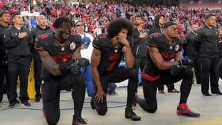 San Francisco 49ers outside linebacker Eli Harold (58), quarterback Colin Kaepernick (7) and free safety Eric Reid (35) kneel in protest during the playing of the US national anthem in October 2016 before a NFL game. Photo: Kirby Lee/USA TODAY Sports