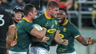 Malcolm Marx is congratulated by captain Siya Kolisi and Jesse Kriel after scoring from a maul against the All Blacks. Photo: John Cowpland/AP