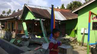 In this photo released by the Disaster Management Agency, a house sits damaged after a magnitude 6.1 earthquake early Friday, Sept. 28, 2018, in Donggala, central Sulawesi, Indonesia. Powerful earthquakes jolted the Indonesian island of Sulawesi on Friday, damaging houses and briefly triggered a tsunami warning. (Disaster Management Agency via AP)