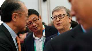 Microsoft founder Bill Gates, right, talks with World Bank President Jim Yong Kim before the opening ceremony of the first China International Import Expo (CIIE) in Shanghai, Monday, Nov. 5, 2018. (Aly Song/Pool Photo via AP)