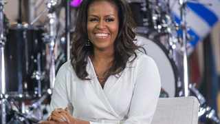 "FILE - In this Oct. 11, 2018, file photo, Michelle Obama participates in the International Day of the Girl on NBC's ""Today"" show in New York. Michelle Obama blasts President Donald Trump in her new book, recalling how she reacted in shock the night she learned he would replace her husband in the Oval Office and tried to ""block it all out."" In her book ""Becoming,"" set to come out on Tuesday, Nov. 13, she denounces the president for bragging to a TV host in 2005 about sexually assaulting women. (Photo by Charles Sykes/Invision/AP, File)"