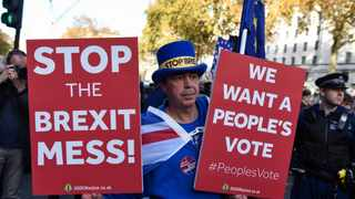 An anti-Brexit demonstrator holds placards on Whitehall outside Downing Street in London. Picture: Stephen Chung/Xinhua