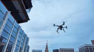 This February 2017 photo provided by DJI Technology Inc. shows a test of a type of drone in downtown Denver, that the New York Police Department can use to reduce risk to officers and bystanders during a response to dangerous situations. The department said Tuesday, Dec. 4, 2018, that potential uses for its 14 drones include search and rescue, hard-to-reach crime scenes, hostage situations, and hazardous material incidents. (DJI Technology Inc. via AP)