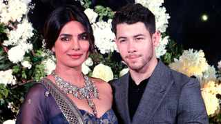 Bollywood actress Priyanka Chopra and musician Nick Jonas stand for photographs at their wedding reception in Mumbai, India, Wednesday, Dec 19, 2018. Picture: AP