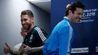 Real Madrid captain Sergio Ramos smiles alongside coach Santiago Solari during a press conference in Abu Dhabi on Friday. Photo: Hassan Ammar/AP