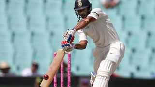 Indian opener Mayank Agarwal drives through the covers against Australia in Sydney on Thursday. Photo: Rick Rycroft/AP