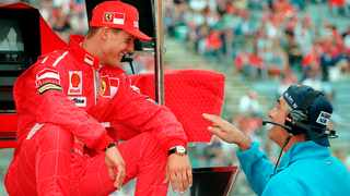 In this July 25, 1997, file photo, Germany's Michael Schumacher, left, of the Ferrari team, shares a joke with Benetton chief Flavio Briatore, right, at the start of the first free practice session for the upcoming German Formula 1 Grand Prix in Hockenheim. Photo: Thomas Kienzle/AP Photo