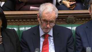 Labour leader Jeremy Corbyn listens as Prime Minister Theresa May makes a statement to MPs in the House of Commons, London. Picture: House of Commons via AP