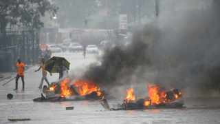 A file picture of barricades burning as rain falls during protests in Harare. File photo: Philimon Bulawayo/Reuters.