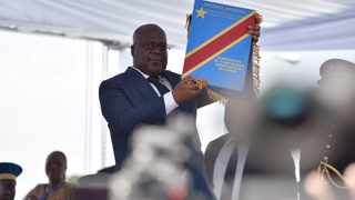 Felix Tshisekedi holds up the constitution during the inauguration ceremony when he was sworn into office as the new president of the Democratic Republic of Congo at the Palais de la Nation in Kinshasa. File photo: Olivia Acland/Reuters.