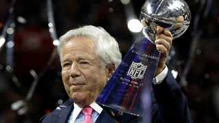 New England Patriots owner Robert Kraft holds the Vince Lombardi trophy after his team won the NFL Super Bowl against the Los Angeles Rams. Photo: Mark Humphrey/AP