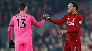 Virgil van Dijk (R) has been a revelation since arriving at Anfield and will be hoping his form continues as they chase the league title. Photo: Russell Cheyne/Reuters