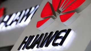 Logos of Huawei are pictured outside its shop in Beijing. Photo: File.