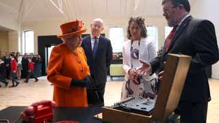 Britain's Queen Elizabeth looks at an Enigma machine at the Smith Centre, as Science Museum Director Ian Blatchford looks on, during a visit to the museum in London. Picture: Simon Dawson/Reuters