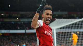 Arsenal's Pierre-Emerick Aubameyang celebrates after scoring a penalty against Manchester United at the Emirates Stadium in London on Sunday. Photo: Eddie Keogh/Reuters