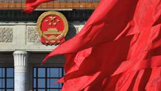 Red flags flutter outside the Great Hall of the People during the closing session of the Chinese People's Political Consultative Conference (CPPCC) in Beijing. Picture: Reuters
