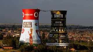 The cooling towers of the defunct Orlando Power Station, a distinctive landmark now used as an advertising display and a bungee jump set up between the cooling towers is seen in Soweto. Picture: African News Agency