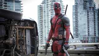 """This image released by Twentieth Century Fox shows Ryan Reynolds in a scene from the film, """"Deadpool."""" Disney will add the R-rated superhero Deadpool, the X-Men and the Fantastic Four to its bench of Marvel characters. Picture: Joe Lederer/Twentieth Century Fox Film Corp. via AP"""