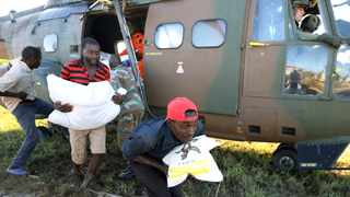 Workers offload food aid from a South African National Defence Force helicopter in the aftermath of Cyclone Idai in Buzi.  Picture: Reuters/Mike Hutchings