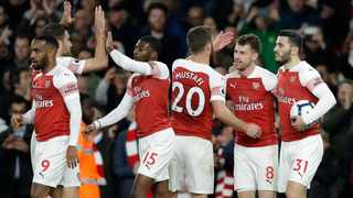 Aaron Ramsey, second from right, celebrates his goal for Arsenal against Newcastle on Monday night. Photo: Kirsty Wigglesworth/AP