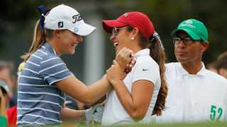 Maria Fassi, of Mexico, right, high-fives Jennifer Kupcho before they tee-off the first hole during the final round of the Augusta National Women's Amateur golf tournament in Augusta on Saturday. Photo: David Goldman/AP