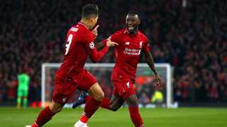 Naby Keita celebrates scoring the opening goal for Liverpool with Roberto Firmino, who netted the second against Porto. Photo: Dave Thompson/AP
