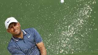 Francesco Molinari, of Italy, hits from a bunker on the second hole during the second round for the Masters golf tournament. Photo: Matt Slocum/AP