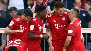 Bayern Munich managed to hold onto their lead at the top of the standings. Photo: Matthias Schrader/AP Photo