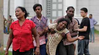 Relatives of a blast victim grieve outside a morgue in Colombo, Sri Lanka. Picture: AP Photo/Eranga Jayawardena