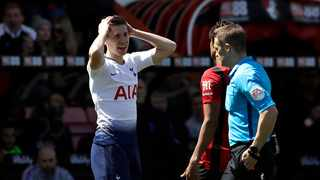Tottenham's Juan Foyth reacts after Referee Craig Pawson showed him a red card during their English Premier League soccer match against AFC Bournemouth at the Vitality Stadium in Bournemouth on Saturday. Photo: Matt Dunham/AP