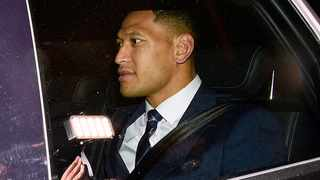 Australian rugby union player Israel Folau leaves a Code of Conduct hearing in Sydney on  Sunday. Photo: Bianca De Marchi/AP